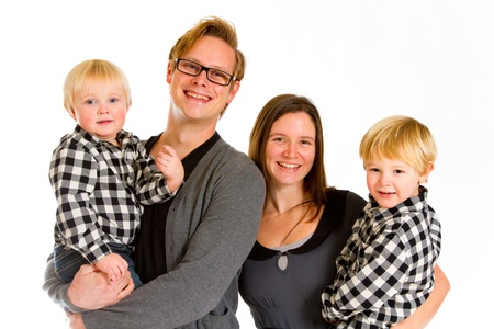 An attractive couple and their two sons against an isolated white background in the studio for a family portrait. Stock Photo - 17515353