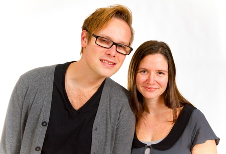 A man and woman pose for this family portrait in the studio against an isolated white background. photo