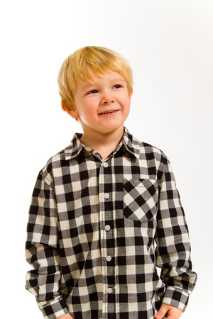 A young boy in a plaid shirt poses for this portrait in the studio against an isolated white background. Stock Photo - 17515261
