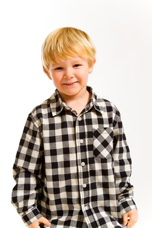 A young boy in a plaid shirt poses for this portrait in the studio against an isolated white background. Stock Photo - 17515277