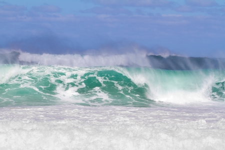 banzai pipeline: These monster waves are coming in by the set and standing over 20 feet tall. The surf is dangerous and the waves are very intimidating but there is a competition for surfers happening at the same time.