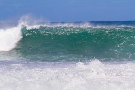 banzai pipeline: The dream of every surfer to find waves like this. These waves are at pipeline on the north shore of Oahu during the winter in a huge storm. Stock Photo