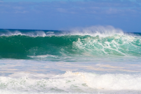 huge: The dream of every surfer to find waves like this. These waves are at pipeline on the north shore of Oahu during the winter in a huge storm. Stock Photo