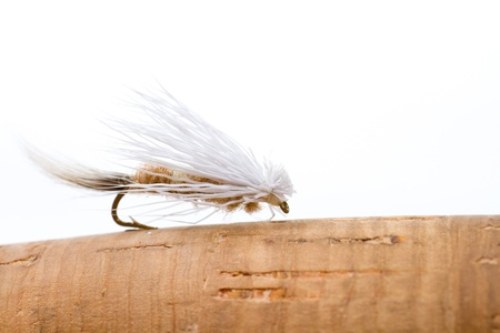 This caddis imitation is made of deer hair and elk hair and tied in an artistic way to attract fish while fishing in lakes streams rivers and creeks on the surface of the water  免版税图像
