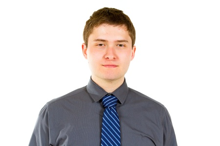 A young adult college student is photographed in the studio agains an isolated white background while wearing a grey shirt. photo