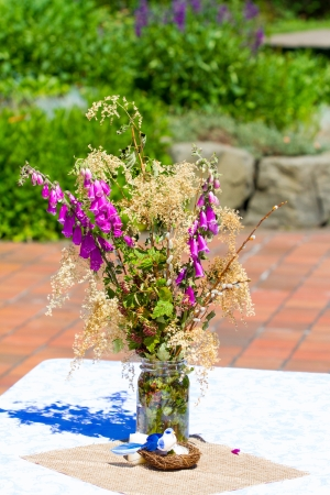 Flowers at a wedding ceremony celebration outdoors at a park.