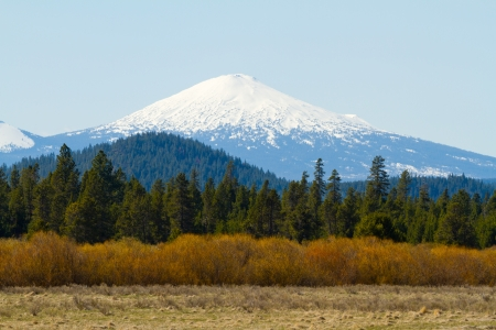 Mount Bachelor in Oregon is photographed from a distance to create this nature scenic landscape of the snow-capped mountain.