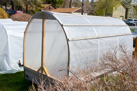 hot house: These hot house greenhouses are built by hand to house peppers in this garden.