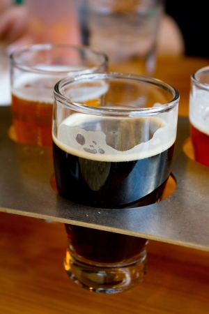 sampler: These craft microbrew beers are in a sampler tray at a brewery in Oregon. Stock Photo