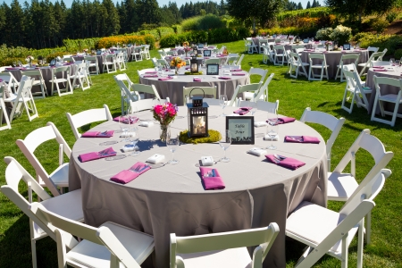 party table: Tables, chairs, decor, and decorations at a wedding reception at an outdoor venue vineyard winery in oregon.