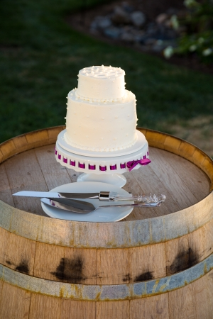 receptions: A wedding cake is ready to be cut at a reception on the bride and groom wedding day. Stock Photo