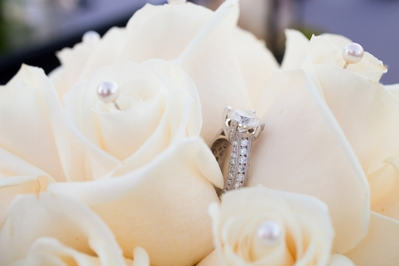 receptions: The rings of a bride and groom are photographed with a macro lens to show the closeup detail of these fine pieces of jewelry.
