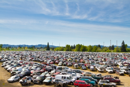 salvage yard: The scene shows many cars and other automobiles in a salvage junk yard where customers can pick and choose part for their vehicle repairs. Stock Photo