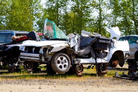 Detail of a vehicle at the auto salvage yard after a major accident collision. Stock Photo