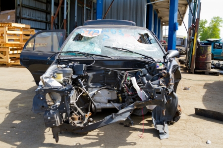salvage yard: Detail of a vehicle at the auto salvage yard after a major accident collision. Stock Photo