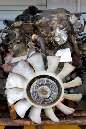 salvage yards: Engine blocks or motors and their gears and working parts are photographed to show the pieces at this junkyard.