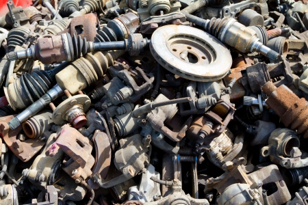 Abstract background color image of pieces at a junkyard auto salvage yard. Stock Photo