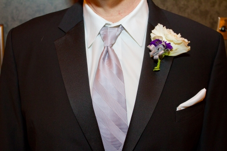 hitched: A groom wearing a fancy tuxedo on his wedding day ready to get hitched.