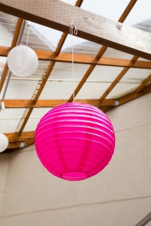 Paper Chinese lanterns are used as decorations or decor for this classy wedding reception.