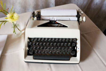 An antique typewriter is used as a guestbook at this wedding ceremony and reception. Banco de Imagens