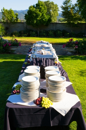 A wedding buffet is setup and ready for the guests at this reception to eat the food. Banco de Imagens