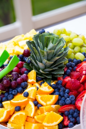 fruit: Tasty food is ready to be served and eaten at this amazing wedding banquet buffet.