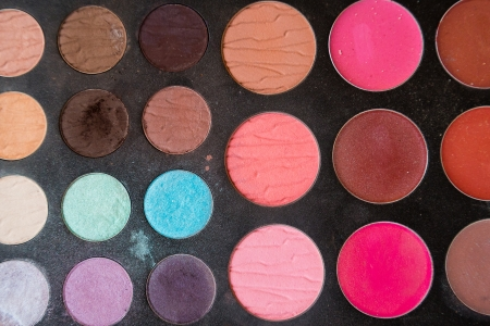 The makeup from a cosmetologist is photographed up close to show the colors and unique details of the powder.