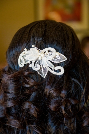 A bride has her hair done by a professional cosmetologist hair stylist at the wedding.