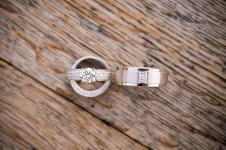 diamond ring: Wedding rings are placed on a wooden box to create this interesting closeup color photo showing love.
