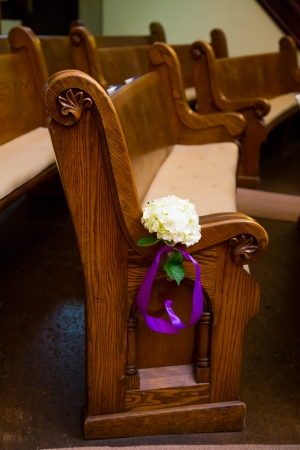 pews: Wood pews are ready for guest seating at this wedding ceremony in a historic old Christian church in Oregon.