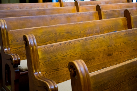 Wood pews are ready for guest seating at this wedding ceremony in a historic old Christian church in Oregon.