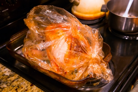 A turkey is cooked in a broasting bag to keep the flavor in and keep the meat moist and juicy.