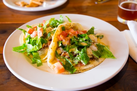 tacos: These fish tacos are a healthy alternative while eating or dining out at a restaurant. Stock Photo