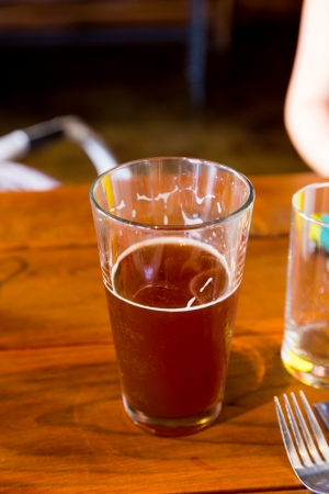 Somone has been drinking this red ale craft rye beer at a local brewery brewpub bar.