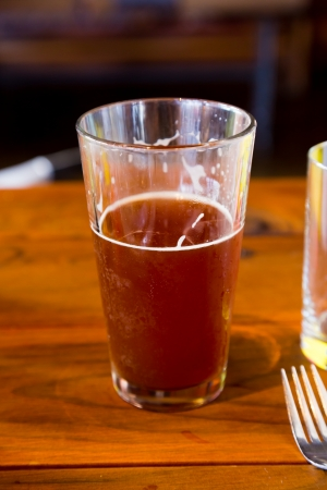 Somone has been drinking this red ale craft rye beer at a local brewery brewpub bar. photo