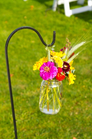 decorate: Flowers are used to decorate at this outdoor wedding venue in the summer in oregon.