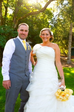 hitched: A bride and groom pose for a casual portrait on their wedding day outdoors in the summer in oregon. Stock Photo
