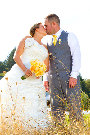 hitched: A bride and groom looking beautiful and handsome on their wedding day outdoors for a portrait session.