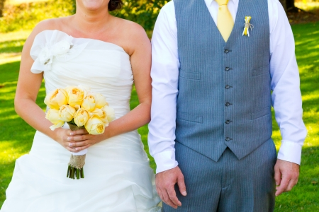 hitched: A bride and groom are photographed and cropped off at the next to create this headless torso image showing their fashion clothing for the wedding day.