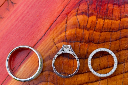 symbolism: Wedding rings in detail shot with a macro lens at a wedding reception. Showing the idea of symbolism and commitment through a jewelry object. Stock Photo