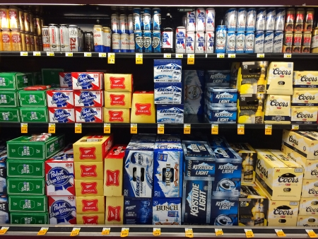 keystone light: SPRINGFIELD, OR - DECEMBER 27: Beer selection in a cooler at Fred Meyer in Springfield, OR on December 27, 2013. Overall beer sales decline in 2013 while craft beer sales rise.
