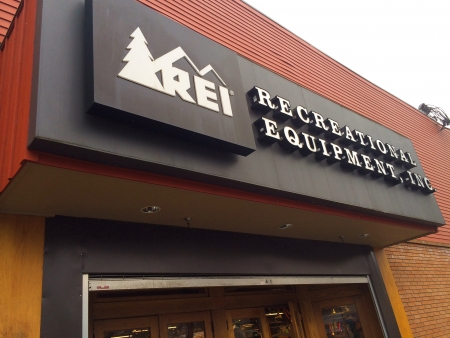 exceeding: EUGENE, OR - JANUARY 1: REI Recreational Equipment, Inc. store entrance sign in Eugene, OR on January 1, 2014. REI is a retailer of outdoor gear with sales exceeding $1.5 billion each year.