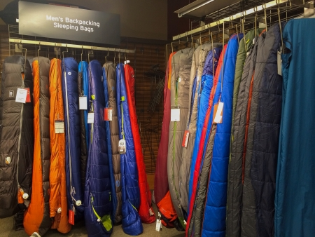 rei: EUGENE, OR - JANUARY 1: REI Recreational Equipment, Inc. sleeping bag selection in Eugene, OR on January 1, 2014. REI is a retailer of outdoor gear with sales exceeding $1.5 billion each year. Editorial