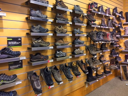 rei: EUGENE, OR - JANUARY 1: REI Recreational Equipment, Inc. footwear selection in Eugene, OR on January 1, 2014. REI is a retailer of outdoor gear with sales exceeding $1.5 billion each year. Editorial