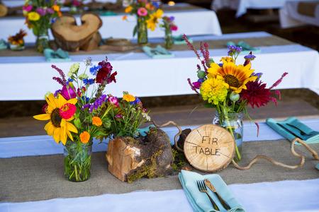 decor: Wedding decor and decorations are made up of wildflowers and crosscut sections of fir trees at this organic natural reception in Oregon.