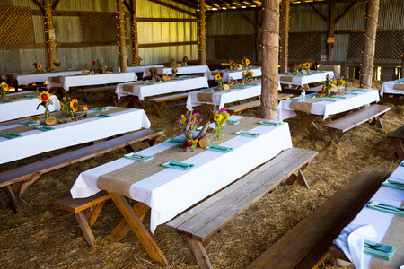 Overview of this wedding reception shows the tables ready for guests with organic natural decor and decorations.