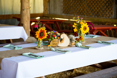 Overview of this wedding reception shows the tables ready for guests with organic natural decor and decorations. photo