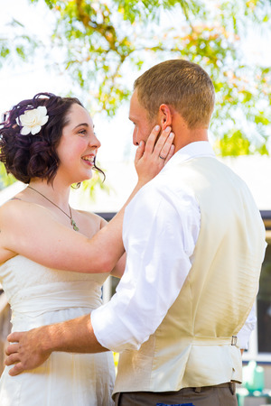 relational: Beautiful bride and handsome groom share a moment during their first look before the wedding ceremony.