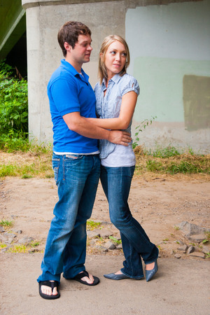 Attractive engaged couple spending time together for a natural portrait. photo