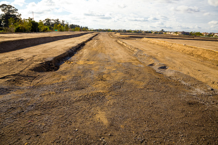 Land is prepped and ready for foundations to be layed at this housing development under construction. photo